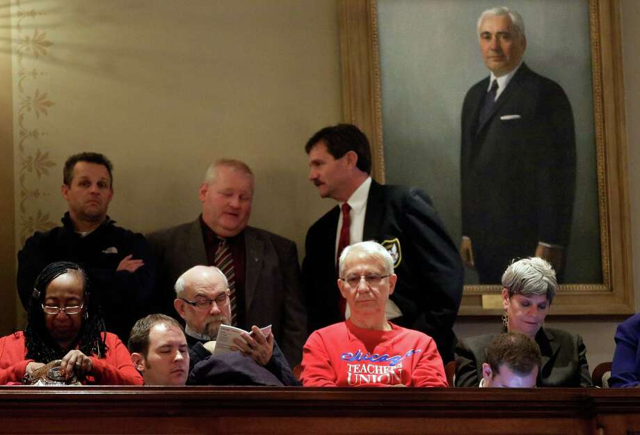 Opponents and backers of the pension-system fix listen from the gallery of the Illinois Legislature on Tuesday. Photo: Seth Perlman, STF / AP
