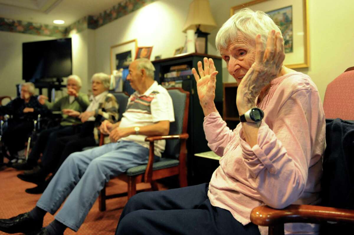 Resident Sister Bea Brennan, 94, right, joins others in yoga class on Wednesday, Nov. 27, 2013, at the Teresian House in Albany, N.Y. (Cindy Schultz / Times Union)