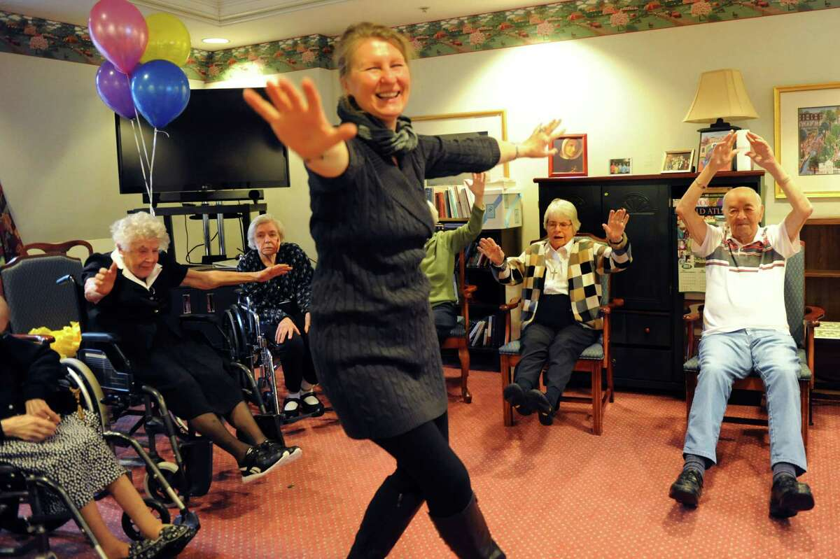 Yoga instructor Mira Lechowicz, center, leads senior residents and guests in a class on Wednesday, Nov. 27, 2013, at the Teresian House in Albany, N.Y. (Cindy Schultz / Times Union)