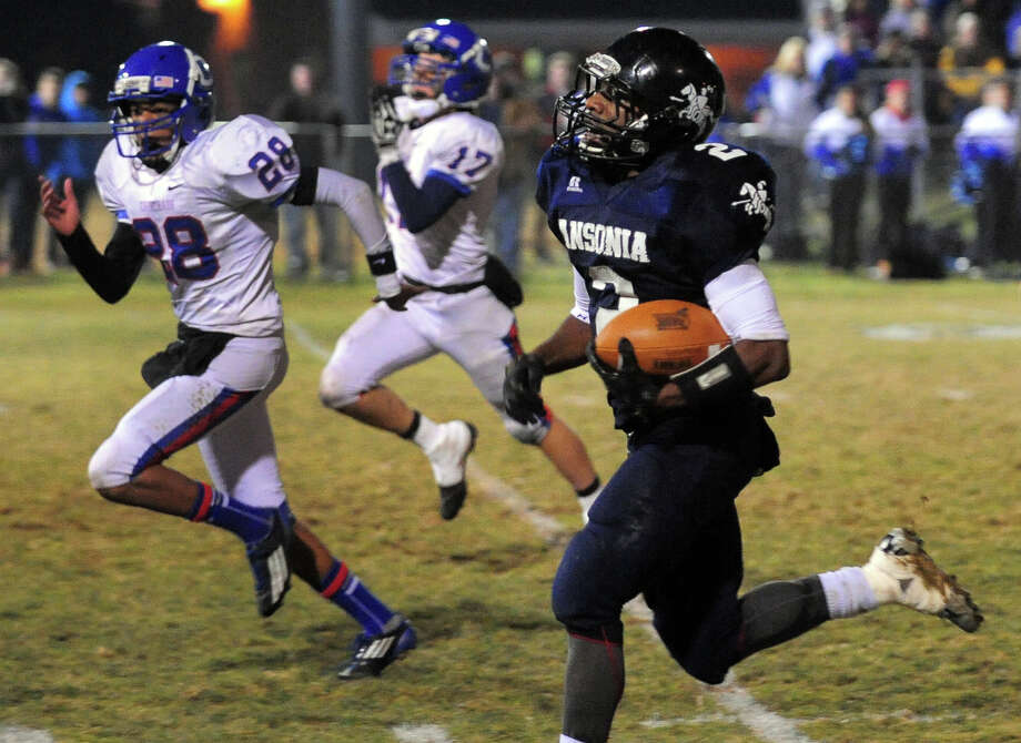 Ansonia's Arkeel Newsome runs to the endzone to score a touchdown, during Class football playoff action against Coginchaug in Ansonia, Conn. on Tuesday December 3, 2013. Photo: Christian Abraham / Connecticut Post