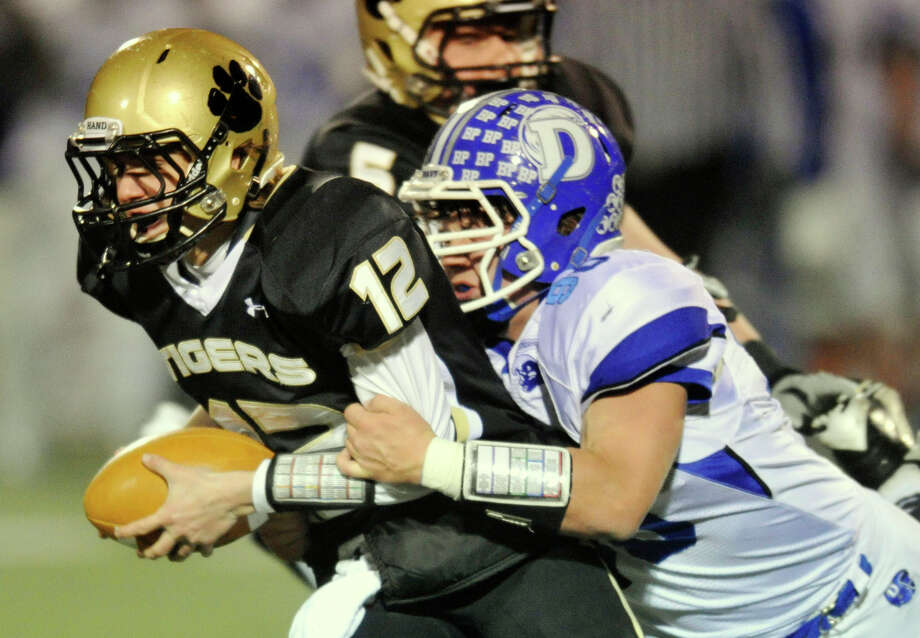 Darien's Mark Evanchick brings down Daniel Hand quarterback Nicolas Van Dell during their Class L quarterfinal game at Brien McMahon High School in Norwalk, Conn., on Tuesday, Dec. 3, 2013. Darien won, 31-29. Photo: Jason Rearick / Stamford Advocate