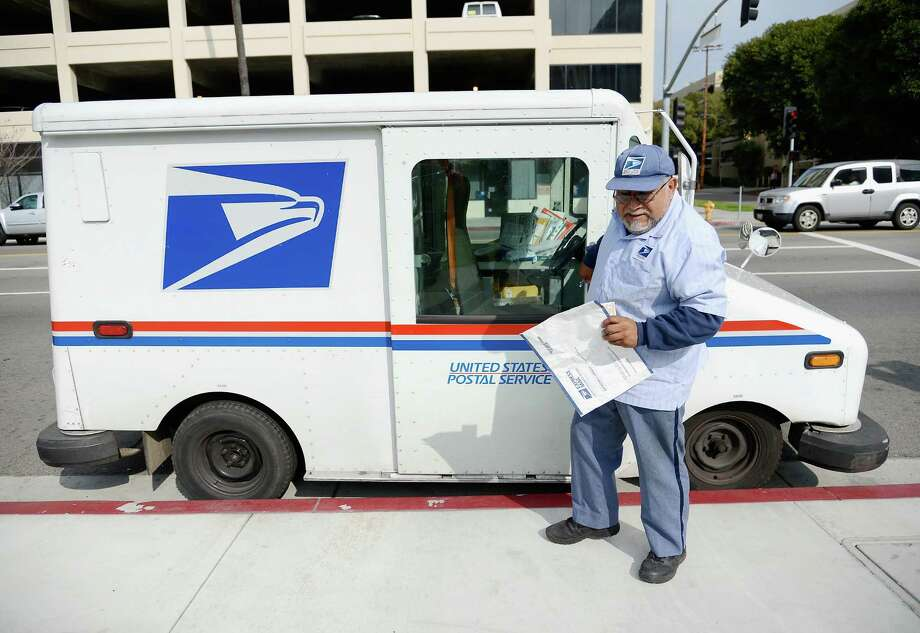 1. Fastest shrinking profession in King County? Postal carriers, sorters and clerks. Their field of about 4,000 workers (in 2011) is dwindling at a rate of 1.7 percent a year, according to the state Employment Security Department.  Photo: Kevork Djansezian, Getty Images / 2013 Getty Images