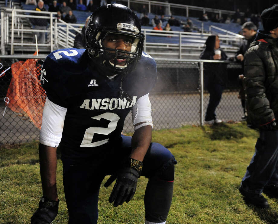 Ansonia's Arkeel Newsome, during Class football playoff action against Coginchaug in Ansonia, Conn. on Tuesday December 3, 2013. Photo: Christian Abraham / Connecticut Post