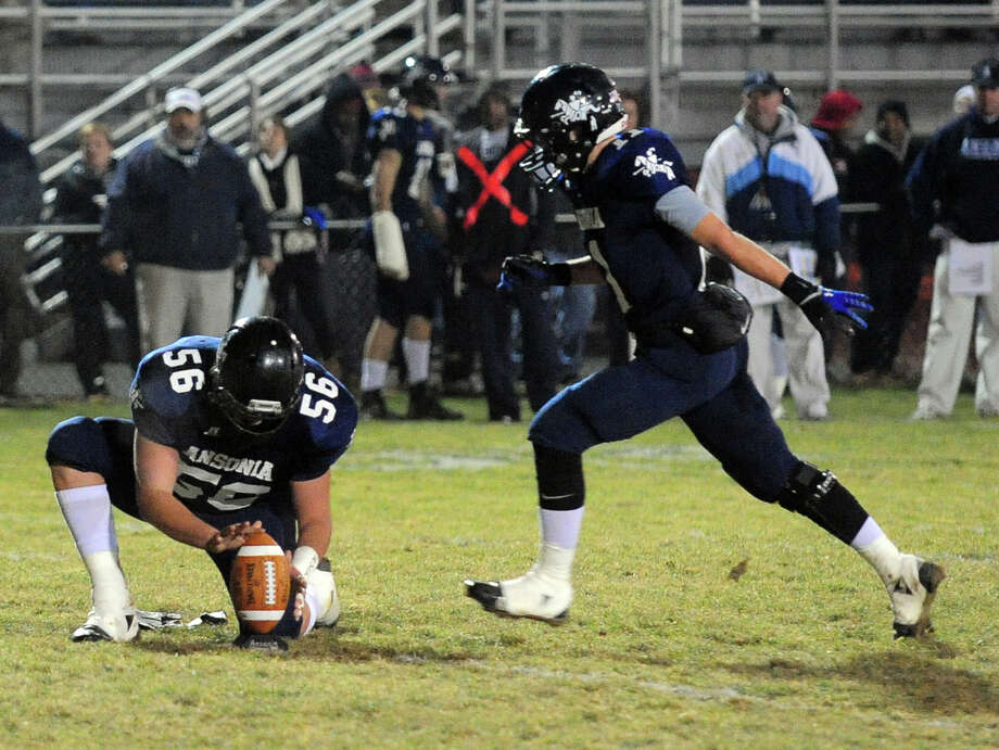 Ansonia's Witold Gul attempts a field goal, during Class football playoff action against Coginchaug in Ansonia, Conn. on Tuesday December 3, 2013. Photo: Christian Abraham / Connecticut Post