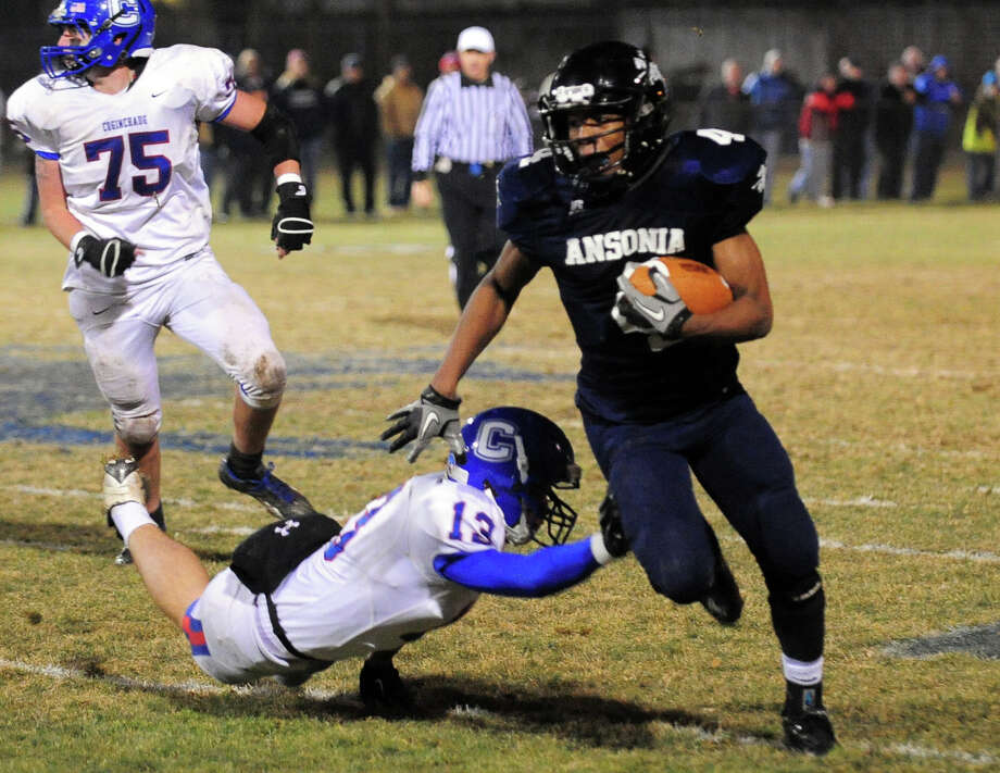Ansonia's Tajik Bagley, during Class football playoff action in Ansonia, Conn. on Tuesday December 3, 2013. Photo: Christian Abraham / Connecticut Post