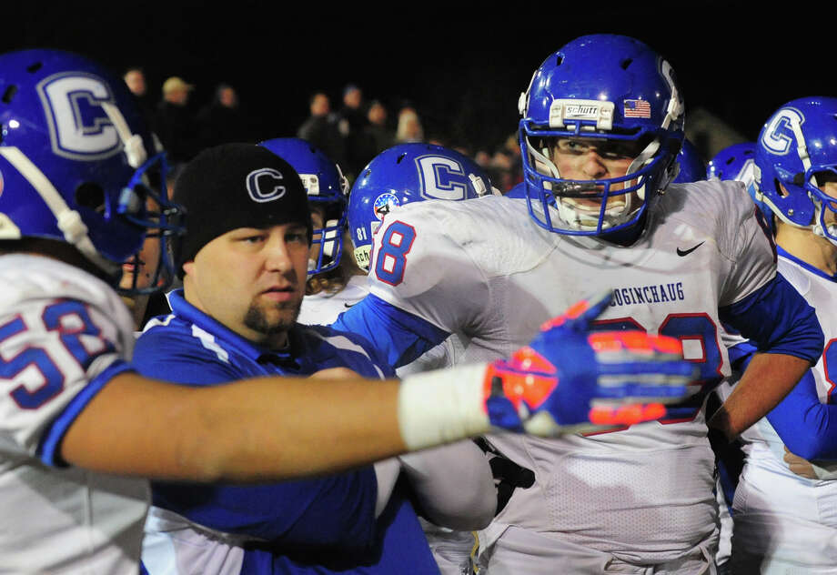 Class football playoff action between Ansonia and Coginchaug in Ansonia, Conn. on Tuesday December 3, 2013. Photo: Christian Abraham / Connecticut Post