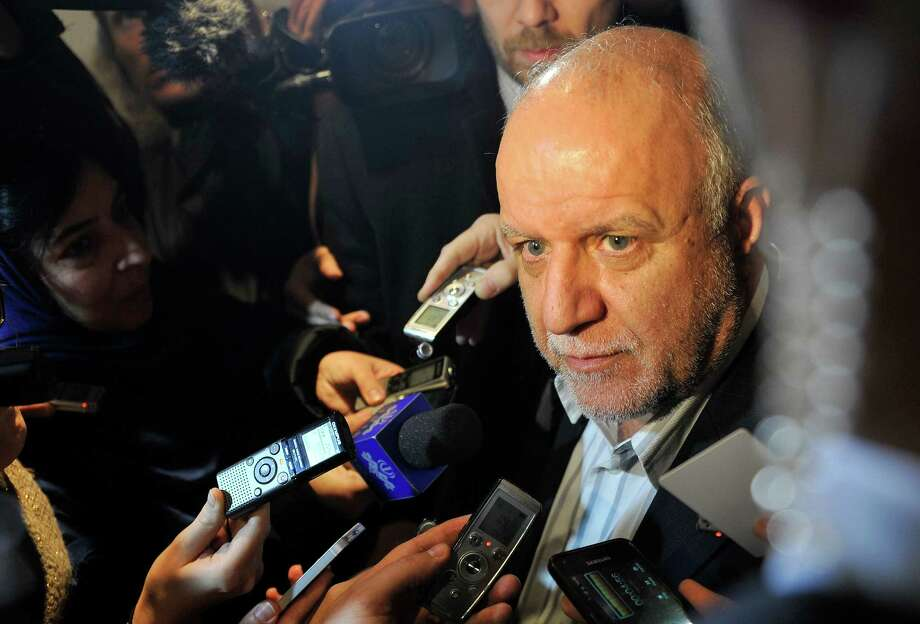 Iran's Minister of Petroleum Bijan Namdar Zangeneh talks ro journalists as he arrives at a hotel in Vienna, Austria, on Tuesday, Dec. 3, 2013. The Organization of Petroleum Exporting Countries, OPEC, will meet on Wednesday to decide on the cartel's oil output against a backdrop of slowing crude demand and unrest in member nation Libya. (AP Photo/Hans Punz) Photo: Hans Punz, STR / AP