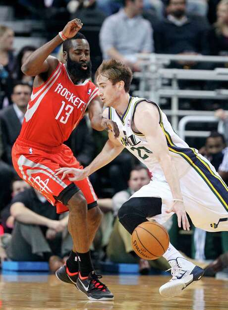 Rockets defenders like James Harden, left, made the Jazz's Gordon Hayward, a 16.9 points per game scorer, look more like Larry Bird in Monday's night's Utah win in which Hayward had 29 points. Photo: Rick Bowmer, STF / AP