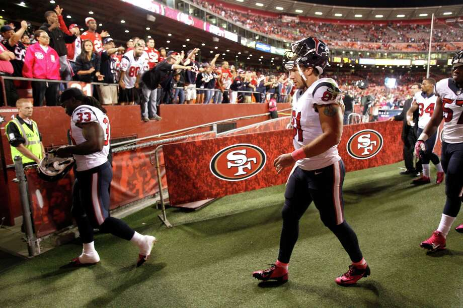 After leaving the field in San Francisco on Oct. 6, Owen Daniels, right, learned he had a fractured fibula that might not have been a season-ending injury. Photo: Brett Coomer, Staff / © 2013  Houston Chronicle