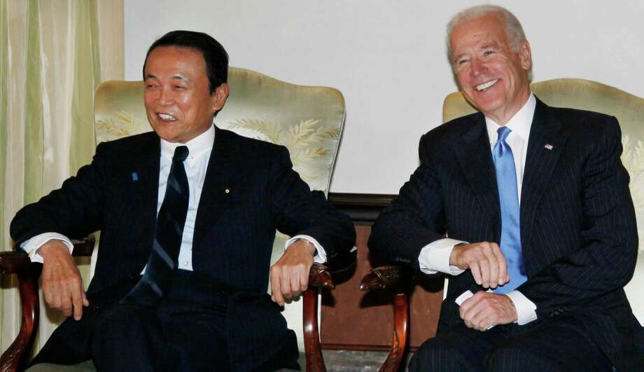 U.S. Vice President Joe Biden, right, talks with Japan's Deputy Prime Minister Taro Aso, on Tuesday. Biden's Asia trip has become a matter of delicate balance. Photo: Koji Sasahara, STF / AP