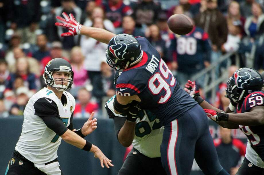 Jacksonville Jaguars quarterback Chad Henne (7) gets off a pass over Houston Texans defensive end J.J. Watt (99) during the first half of an NFL football game on Sunday, Nov. 24, 2013, in Houston. ( Smiley N. Pool / Houston Chronicle ) Photo: Smiley N. Pool, Staff / © 2013  Houston Chronicle