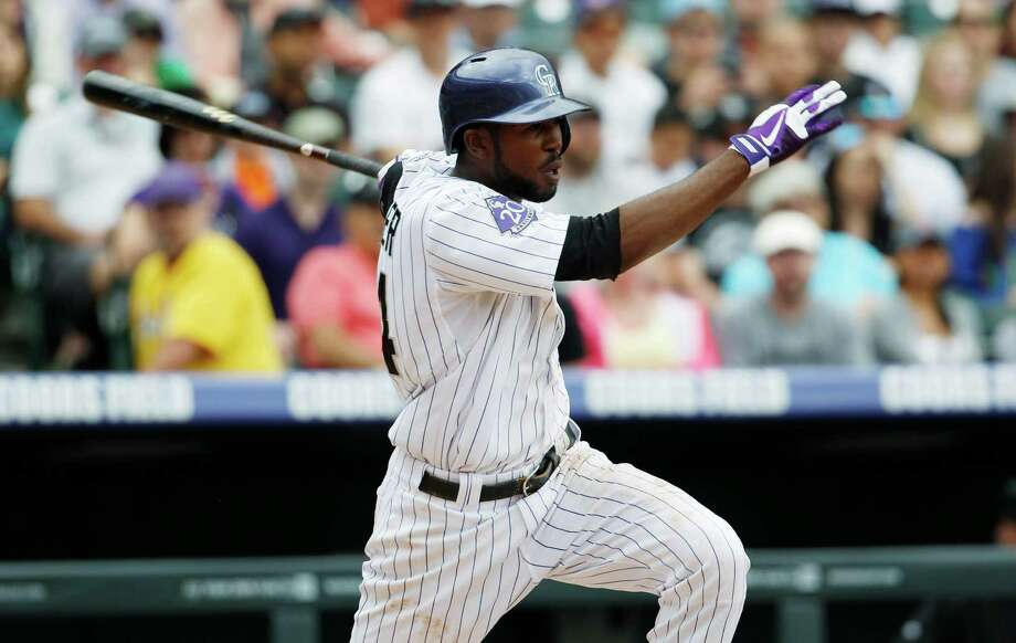 Dexter Fowler strokes a single at Coors Field, where his lifetime average of .298 is 57 points higher than his average everywhere else. Photo: David Zalubowski, Stf / AP