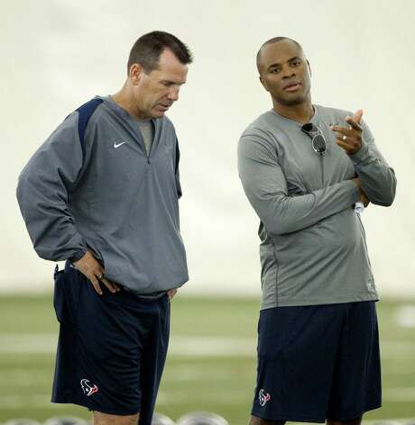 Houston Texans head coach Gary Kubiak and general manager Rick Smith talk at the end of practice during Texans training camp at the Methodist Training Center Monday, July 30, 2012, in Houston.  ( Brett Coomer / Houston Chronicle ) Photo: Brett Coomer, Staff / © 2012 Houston Chronicle