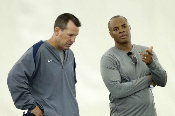 Houston Texans head coach Gary Kubiak and general manager Rick Smith talk at the end of practice during Texans training camp at the Methodist Training Center Monday, July 30, 2012, in Houston.  ( Brett Coomer / Houston Chronicle )
