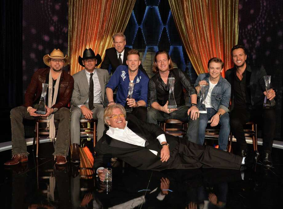 NASHVILLE, TN - DECEMBER 03: CMT's John Hamlin (standing), Jason Aldean, Tim McGraw, Florida Georgia Line, Hunter Hayes, Luke Bryan, and Ron White gather on stage after the CMT Artists Of The Year 2013 at Music City Center on December 3, 2013 in Nashville, Tennessee. Photo: Rick Diamond, Getty Images For CMT / 2013 Getty Images