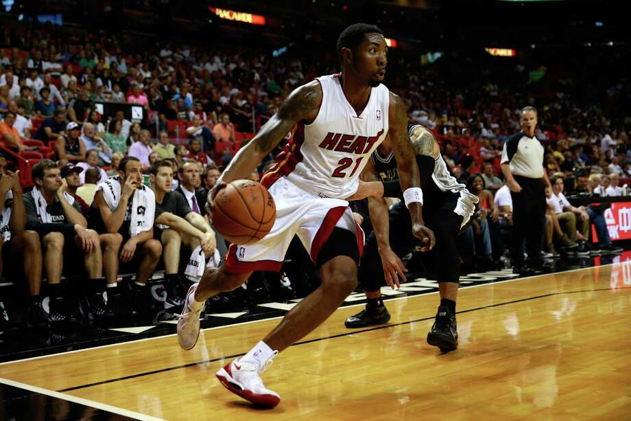 Roger Mason Jr.,guard, started season for Heat, averaged 3.0 points, 0.9 rebounds, 0.8 assists; traded to Kings on Feb. 20, 2014.