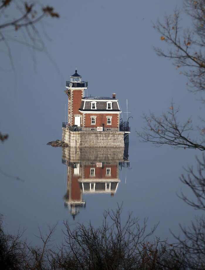 The Hudson-Athens Lighthouse is reflected in the Hudson River on Tuesday, Dec. 3, 2013, in Hudson, N.Y. (AP Photo/Mike Groll) Photo: Mike Groll, Associated Press