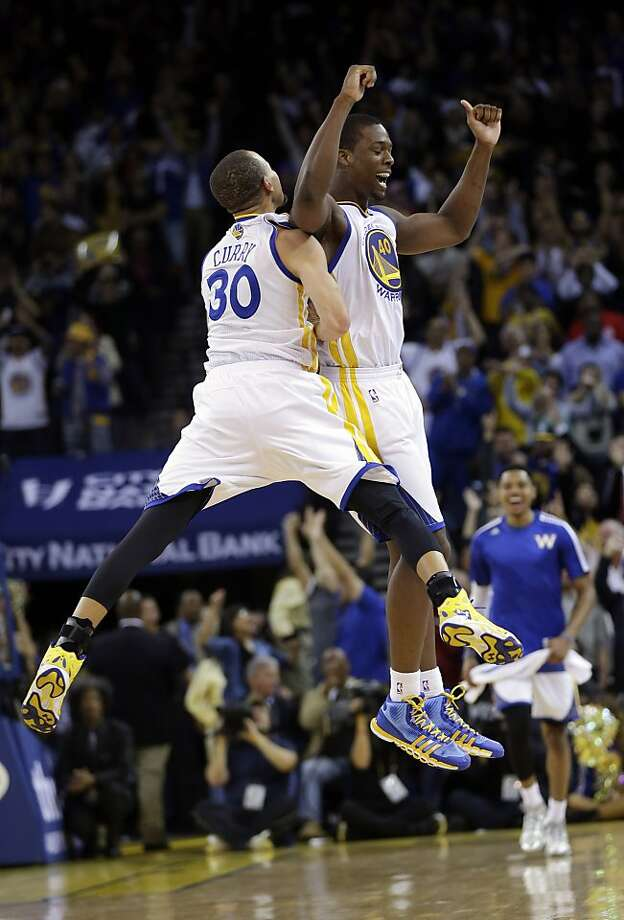 Stephen Curry and Harrison Barnes enjoy some air time during the Warriors' comeback. Photo: Marcio Jose Sanchez, Associated Press