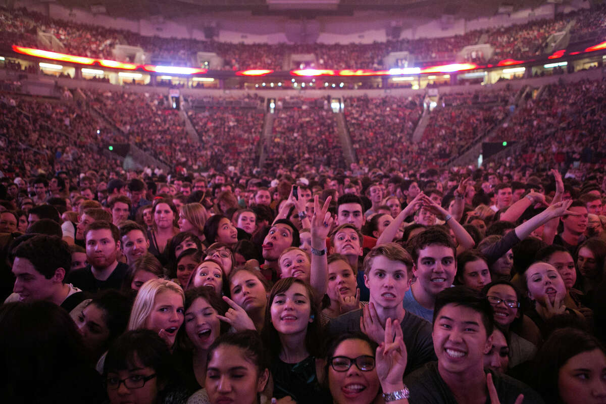 A crowd waits for a band to take the stage during the Deck The Hall Ball at KeyArena on Tuesday, Dec. 3, 2013.