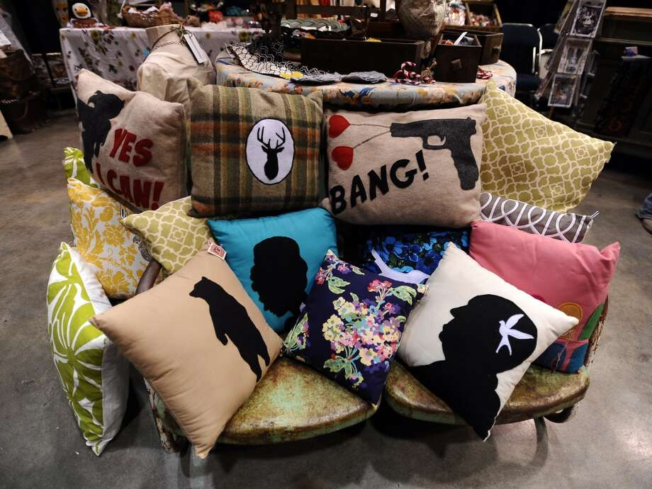 Custom pillows from Lola's Fresh Produce are available for purchase during the Main Street Market on Thursday, November 29, 2012.  The market, presented by the Junior League of Beaumont, opened Thursday night, continues from 10 a.m. to 7 p.m. Friday and Saturday and 11 a.m. to 5 p.m. Sunday at the Beaumont Civic Center. Friday morning at 10 a.m., guests can take part in the Holiday Happy Hour brunch, which includes a style show and entertainment. On Saturday, Jingle and Mingle with a style show, entertainment, children's workshop and story time. Santa will be available from 10 a.m. to 2 p.m. Saturday for photos with kids. On Sunday, go Cruisin' to Christmas with a style show and entertainment. Throughout the four-day event, vendors will offer jewelry, accessories, clothing, shoes, handbags, maternity items, children's clothing, unique toys, home and holiday décor, food items, wine and more. Admission is $5 for adults and free for children 12 and younger. Photo taken: Randy Edwards/The Enterprise