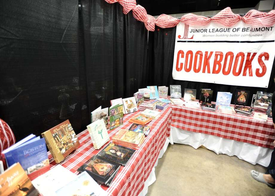 Custom cookbooks from the Junior League are available for purchase during the Main Street Market on Thursday, November 29, 2012.  The market, presented by the Junior League of Beaumont, opened Thursday night, continues from 10 a.m. to 7 p.m. Friday and Saturday and 11 a.m. to 5 p.m. Sunday at the Beaumont Civic Center. Friday morning at 10 a.m., guests can take part in the Holiday Happy Hour brunch, which includes a style show and entertainment. On Saturday, Jingle and Mingle with a style show, entertainment, children's workshop and story time. Santa will be available from 10 a.m. to 2 p.m. Saturday for photos with kids. On Sunday, go Cruisin' to Christmas with a style show and entertainment. Throughout the four-day event, vendors will offer jewelry, accessories, clothing, shoes, handbags, maternity items, children's clothing, unique toys, home and holiday décor, food items, wine and more. Admission is $5 for adults and free for children 12 and younger. Photo taken: Randy Edwards/The Enterprise