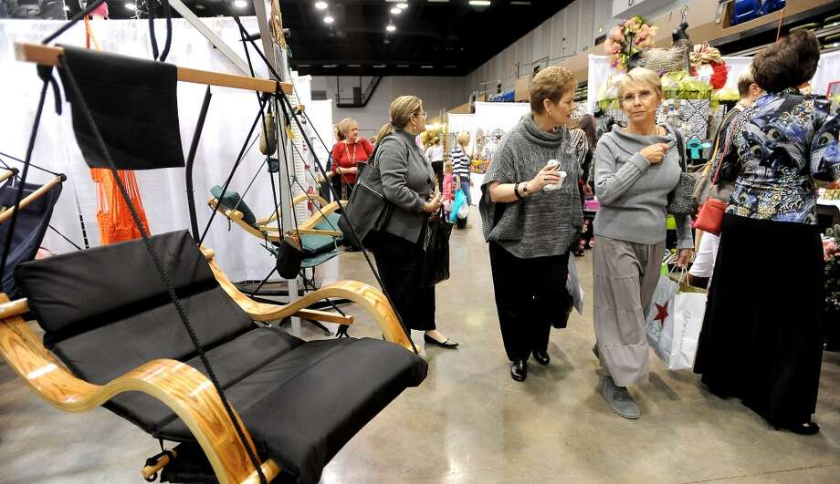 Hundreds of shoppers browse the merchandise during the A Very Merry Main Street Market at the Civic Center in Beaumont, Thursday, December 1, 2011. The market, presented by the Junior League of Beaumont, continues from 10:00 am to 9:00 pm Friday and 10:00 am-6:00 pm Saturday. Friday events include aholiday luncheon and style show honoring Michele Smith at 11:00 am. Luncheon tickets are $40.00 and include admission to the market. Events on Saturday include live entertainment and a children's workshop from 10:00 am-2:00 pm with gingerbread houses, reindeer food, Santa photos and letters. Children's workshop tickets are $25.00 and Santa photos are $10.00. Market admission for adults is $5.00. Children under 17 are admitted free. Tammy McKinley/The Enterprise