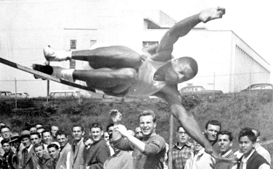 The great Bill Russell wasn't just a basketball player; check him out clearing the high jump during his years at USF. This shot was taken on May 1, 1956. Photo: Bob Campbell, The Chronicle