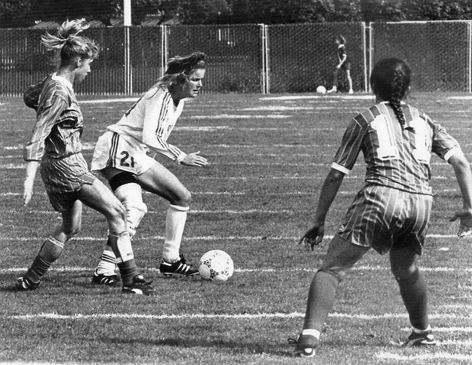Brandi Chastain of the 1989 Santa Clara women's soccer team carries the ball upfield against defenders at Buck Shaw Stadium. She took the Broncos to the Final Four twice. Ten years later, she'd become the subject of one of the most iconic sports photos in history when she ripped off her jersey at the 1999 Women's World Cup. Photo: Santa Clara, Collegiate Images/Getty Images