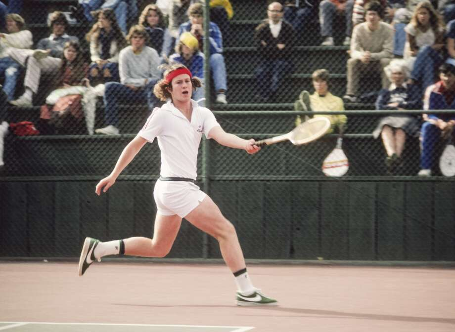 Stanford freshman John McEnroe, sporting that signature hair, hits a forehand during an NCAA singles tennis match against Cal in 1978. The year before, he'd won the mixed doubles title at the French Open as an 18-year-old amateur. Photo: David Madison, Getty Images