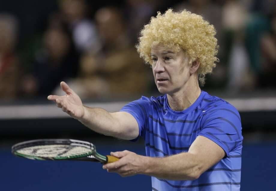 McEnroe won seven Grand Slam singles titles and nine more in doubles. These days, he's a lot more laid back, as you can see in this goofy shot from a recent charity function. Photo: Shizuo Kambayashi, Associated Press