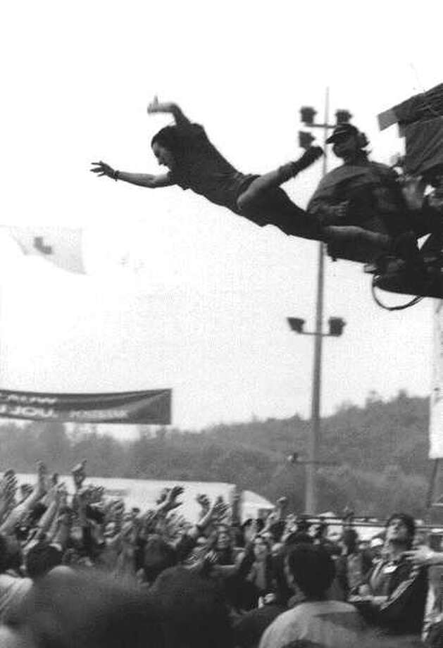 Watch Eddie Vedder launch himself from a TV mast into the waiting crowd.
