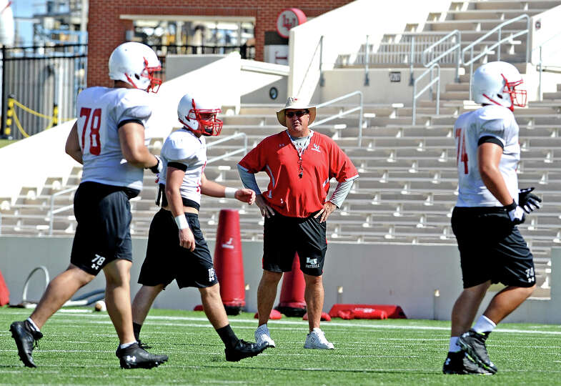 Coach Ray Woodard looks over the Lamar University football scrimmage on Saturday, August 24, 2013. P