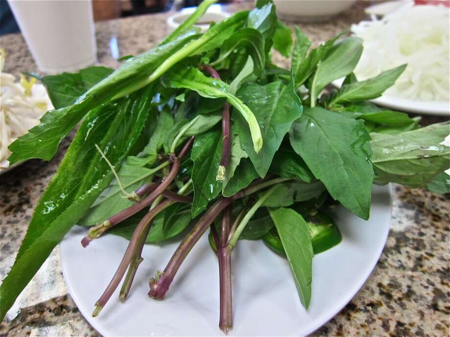 Herb plate with culantro at Pho Hung. Photo: Alison Cook