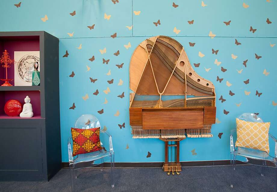 The interior of a grand piano doubles as wall art. Photo: Peter Yang/MTV