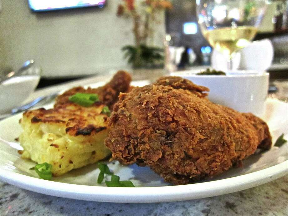 Fried chicken is served with a square of mac-and-cheese at Heights General Store. Photo: Alison Cook