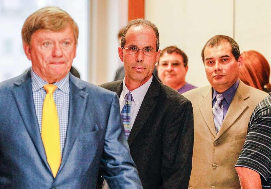 Attorney Rusty Hardin, Sharpstown High School principal Rob Gasparello and asst. principal Silvio Leiva walk out of the courtroom (Johnny Hanson / Houston Chronicle)