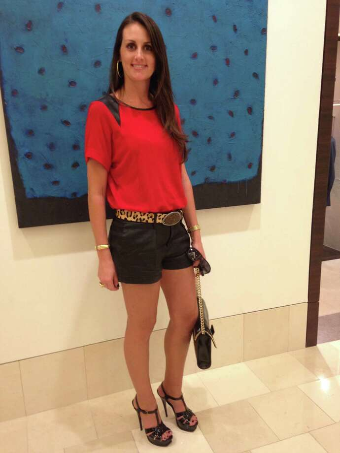 Stacy Harding is fashionably prepared for San Antonio's up and down weather. Here she sports a fall warm-weather day look in leather shorts topped with a leather-inset red blouse. She accessorizes with an on-trend exaggerated leopard-print belt, platform heels and a Jimmy Choo chain handbag. -Michael Quintanilla Photo: Photos By Michael Quintanilla / San Antonio Express-News