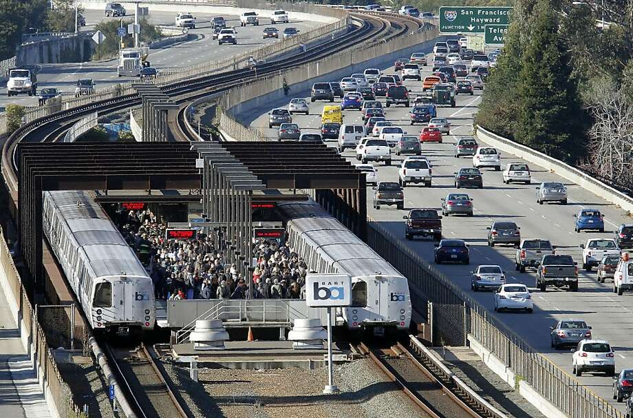 BART passengers at the Rockridge Station exit a train that had been stuck in a tunnel. Photo: Michael Macor, The Chronicle