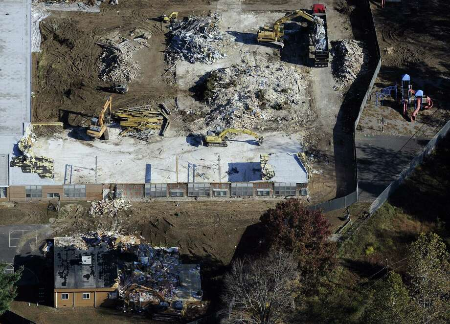 Workers dig through the rubble during Sandy Hook Elementary School's demolition. Twenty-six, including 20 first-graders, died in a shooting last year. Photo: Jessica Hill / Associated Press