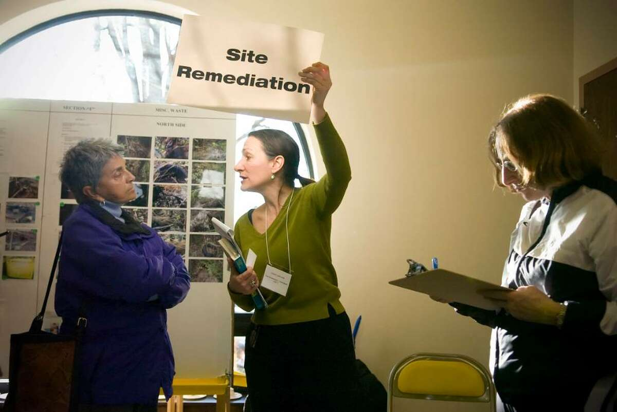 Marianne Bonura, left, talks to Diane Lauricella, center, after the North Stamford Concerned Citizens for the Environment (NSCC) held a 2-hour meeting at Villa Maria in Stamford on Sunday to discuss the NSCC's response to the city-commissioned report that says toxins did not come from the former dump site.