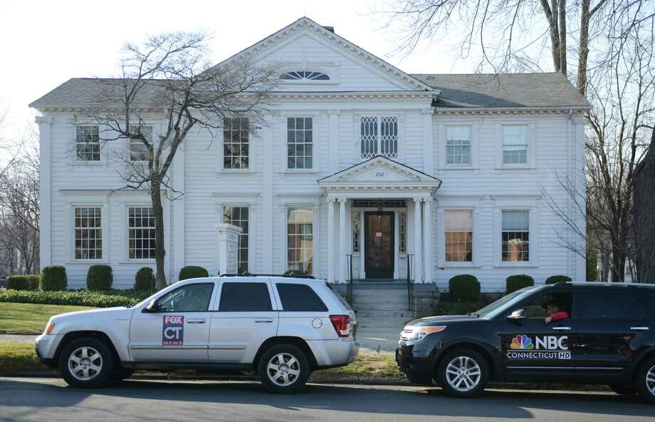 News trucks gather in front of the law office of Cohen and Wolf awaiting the public release of 911 calls from Sandy Hook Elementary the morning of the shooting in Danbury, Conn. on Wednesday, Dec. 4, 2013.  The tapes show town responders calmly assuring the callers that help is on its way.  A court ordered the release of the tapes last week, despite the objections of prosecutors, after a legal challenge by The Associated Press. Photo: Tyler Sizemore / The News-Times