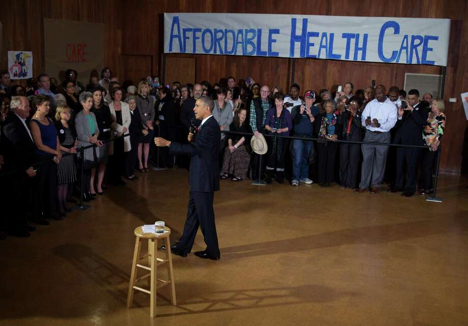 President Barack Obama meets with navigators for HealthCare.gov. A reader says  the rants on both sides of the political aisle are meaningless until studies determine how the act is — or is not — helping people. Photo: Doug Mills, New York Times / NYTNS