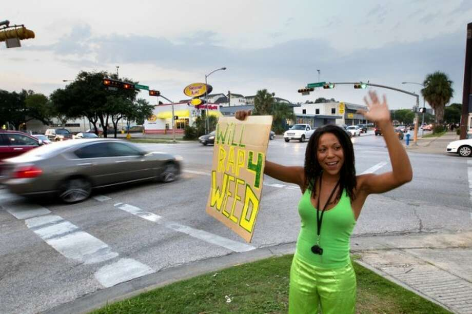"""Yvette GbalazehGbalazeh caught the eyes of plenty of drivers at Montrose and Westheimer, and the ear of the local news media, when she took to the streets with a promise to """"rap 4 weed."""" She said her goal is to get the word out about legalizing marijuana."""