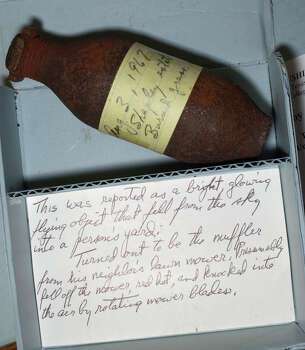 9/25/2003--The Roy Craig Collection housed at Texas A & M University's Cushing Library is a compilation of the efforts of a field investigator for the US Air Force's Condon Report. On display Thursday in the library's Kelsey Reading Room were artifacts such as a lawnmower muffler described as a red hot object that fell from the sky. Librarian Howell Hall made the collection available.    Photo  by Steve Ueckert / Chronicle.  HOUCHRON CAPTION (10/05/2003 - 2-STAR):  A purported red-hot object that fell from the sky turned out to be this lawn mower muffler.   HOUCHRON CAPTION (10/05/2003):  An object that fell from the sky was actually a lawn mower muffler. Photo: Steve Ueckert, Houston Chronicle / Houston Chronicle