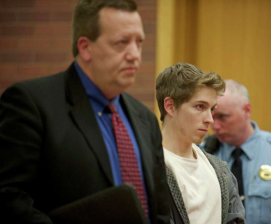 Alexander Lee, 21, appears in superior court in Danbury, Conn, on Wednesday , December 4, 2013,for his arraignment on charges he fled the scene after a cyclist from Weston hit his car on Route 302 in Bethel earlier this year. He was held on $150,000 bail. On left is his attorney Kevin P. Chamberlin. Photo: H John Voorhees III / The News-Times Freelance