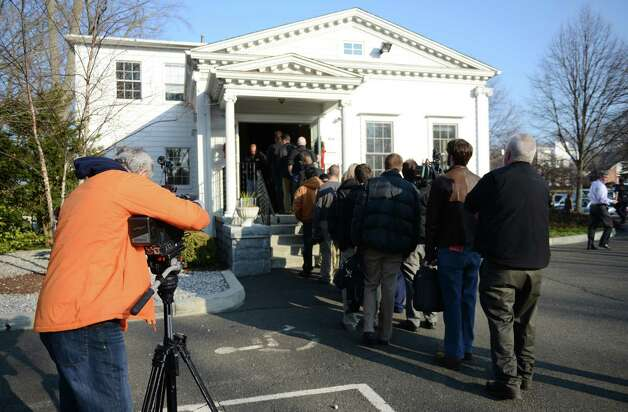 Members of the media stand outside the law office of Cohen and Wolf awaiting the public release of 911 calls from Sandy Hook Elementary the morning of the shooting in Danbury, Conn. on Wednesday, Dec. 4, 2013.  The tapes show town responders calmly assuring the callers that help is on its way.  A court ordered the release of the tapes last week, despite the objections of prosecutors, after a legal challenge by The Associated Press. Photo: Tyler Sizemore / The News-Times