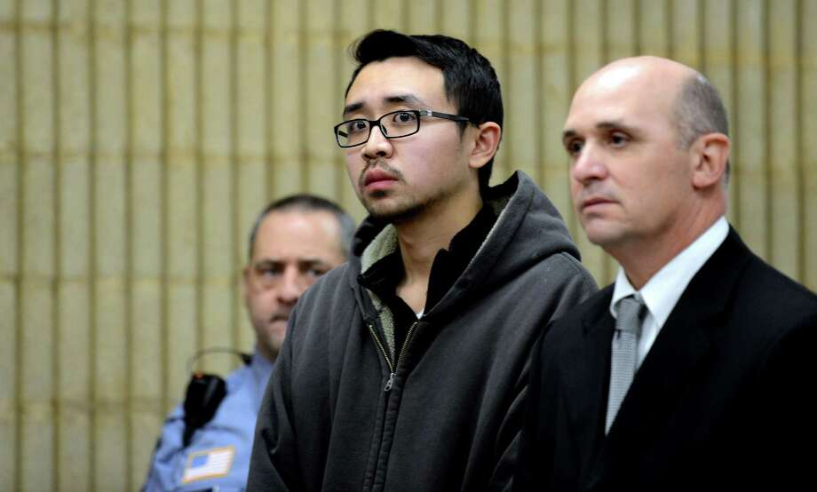 University of New Haven student William Dong, 22, of Fairfield, with Assistant Public Defender Kevin Williams, is arraigned Wednesday, Dec. 4, 2013 at Superior Court in Milford, Conn. on weapons charges following an incident at the University of New Haven. Photo: Autumn Driscoll / Connecticut Post