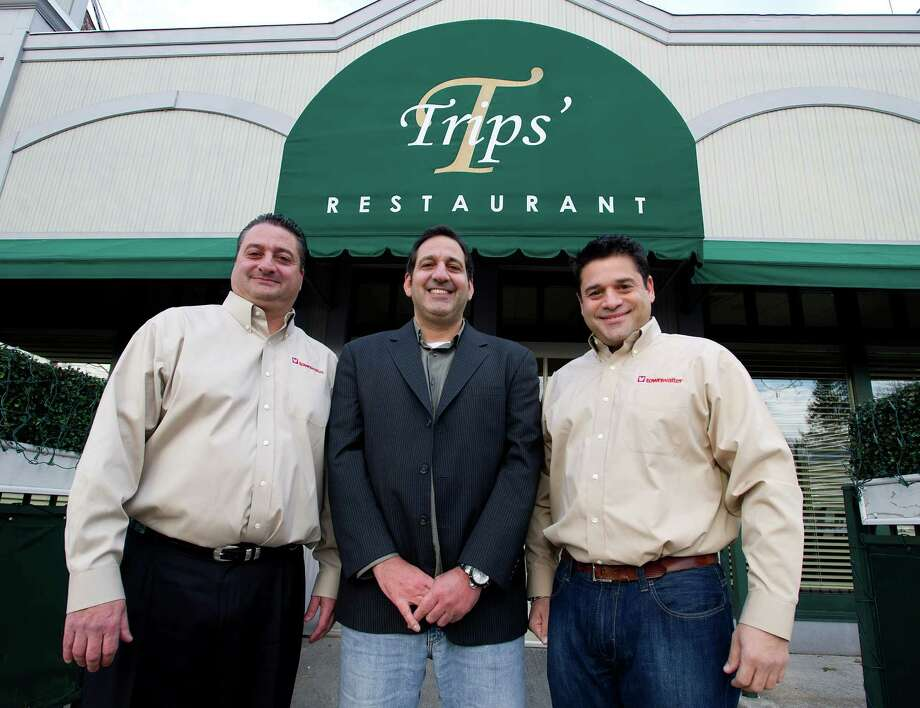 Townwaiter co-founders, from left, Joe Porricelli, Chief Marketing Officer; Michael Porricelli, CEO, and Stephen DiTomasso, Chief Operating Officer, pose for a photo outside Trips' Restaurant in Stamford, Conn., on Wednesday, December 4, 2013. Townwaiter is a new business which gives area restaurants an online ordering platform, and Trips' is one of the first Stamford restaurants to sign up. Photo: Lindsay Perry / Stamford Advocate