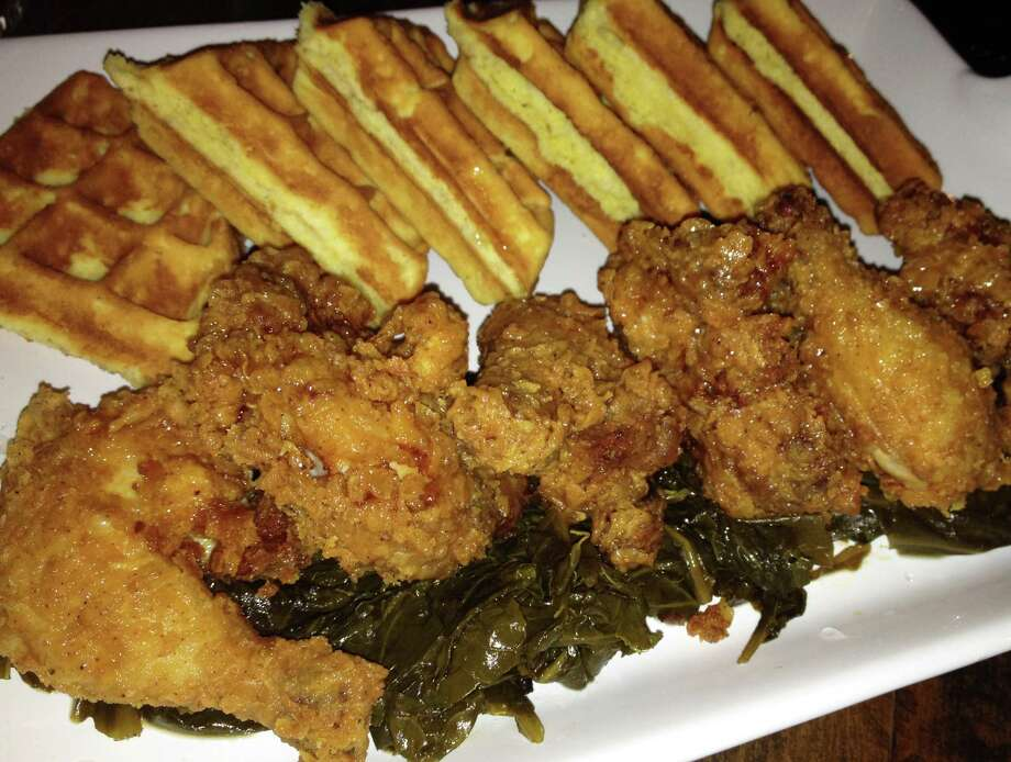 Chicken and waffles is likely to be a signature dish of 2014. Here, the interpretation of the entrée at Mama's Boy restaurant in South Norwalk. Photo: Patti Woods / Fairfield Citizen contributed