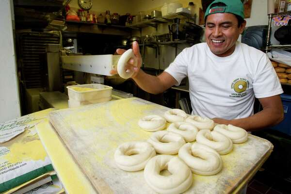 Ricardo Gomez, Executive Baker at Upper Crust Bagel Company in Greenwich, Conn., makes bagels as the store celebrates its 20th birthday at 197 Sound Beach Ave. on Wednesday, December 4, 2013.